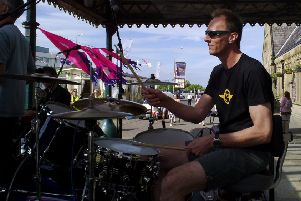 Drummer Steve Hughes playing with Blues band The Hustle.