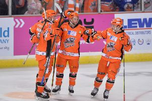 Michael Davies, second right, celebrates his fifth-minute power play opener for the Steelers against Fife. Picture: Dean Woolley.