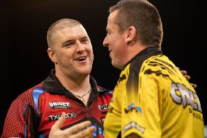 Daryl Gurney and Dave Chisnall at the Unibet European Championship. Picture: Kais Bodensieck/PDC Europe