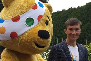 BBC Children in Need's Pudsey Bear with Josh Marshall who is in Team Rickshaw.