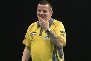 Dave Chisnall was knocked out in the quarter-finals by Peter Wright           Picture: Lawrence Lustig/PDC