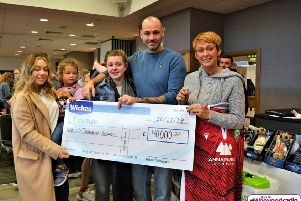 Emma Ellis and family collect their cheque from Wickes staff at the family fun day. Photo credit: Andy Slack, Beyond Radio.