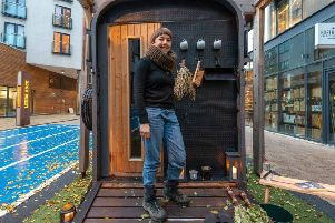 Bethany Wells outside the converted horse box sauna. Photo by Lizzie Coombes