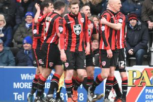 Morecambe players celebrate a Kevin Ellison goal in 2016