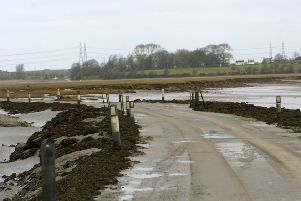 The Sunderland Point road gets cut off by the tide.