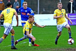 Charlie Bailey blasts in Lancaster City's first. Picture: Tony North