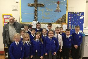 Thurnham Glasson Primary School pupils with poet Bryan Griffin.