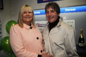 Rennick with partner Sue at the Betfred shop in Heysham.
