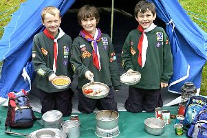 Young scouts prepare a meal