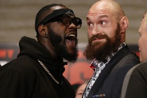 Deontay Wilder and Tyson Fury (right) clash ahead of their world title showdown