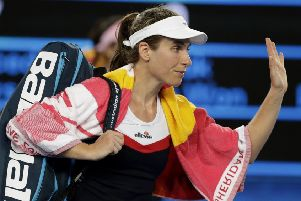 Britain's Johanna Konta waves as she leaves the court following her second round loss to Spain's Garbine Muguruza. Picture: AP/Mark Baker