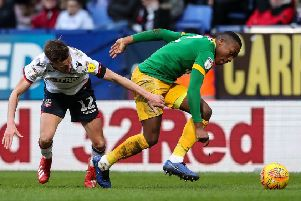 Darnell Fisher takes on Bolton winger Craig Noone