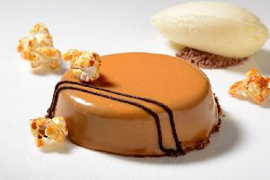 Chocolate mousse dessert with caramel glaze and salted caramel popcorn