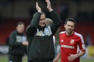 Simon Grayson salutes the PNE fans after his first game in charge of the Lilywhites