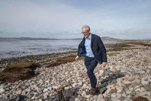 Labour leader Jeremy Corbyn walking on the beach after canvassing in Morecambe while on the local elections campaign. Pic: Jason Roberts/PA Wire