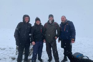 Sam Nicholls, Tom Smith, Michael Griffiths, Adam Holt and Bentley at Pen-y-ghent on their Yorkshire Three Peaks Challenge for Rosemere Cancer Foundation