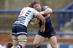 Pitched battle: Lewis Wilson of Yorkshire Carnegie tackles Doncaster Knights' Mat Clark (Picture: Tony Johnson)