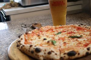 Pizza with Italian Beer.