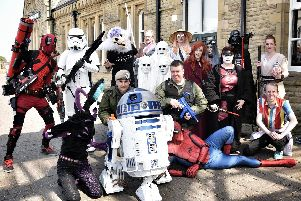 Group pose for pictures in costume at Morecambe Comic Con.