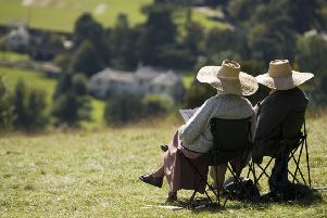 ADOBE STOCK'Two elderly people relaxing in the summer sunshine Box Hill near Dorking Surrey England UK