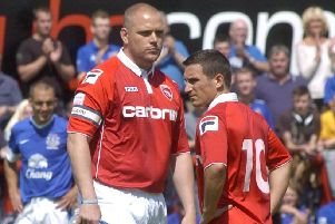 Jim Bentley kicks off his testimonial between Morecambe and Everton at the Globe Arena in 2012