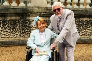 Den Bray at Buckingham Palace with wife Judith.