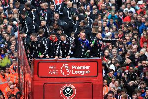 We're on our way: Sheffield United players and manager Chris Wilder wave to the fans during the promotion parade.