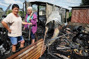 Allotment holders Maria Wright, left, and Jean sift through the wreckage at the Fleetwood Road allotments in Wesham after an arson attack there in August 2017