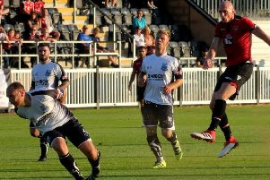 Kevin Ellison in action during last year's pre-season trip to Bamber Bridge, whom the Shrimps visit on Saturday