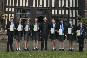 It's double celebrations as pupils also achieve the CYMFED Silver Award from Bishop John Arnold