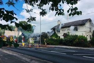 Four fire engines and an aerial ladder platform are tackling the blaze at the historic pub Pic credit: Gordon Head