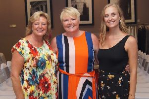 Sallyann Petts (centre) at the strawberry tea party at Eastwood Hall with sister Jacqueline and niece Laura.