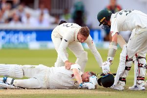 Australia's Steve Smith ends up on the floor after being hit by the ball.