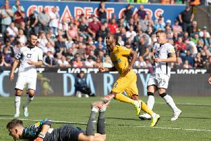 Preston midfielder Daniel Johnson beats Swansea keeper Freddie Woodman from the penalty spot