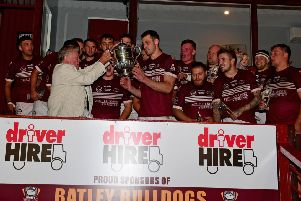 Thornhill Trojans go up to lift the Jim Brown Cup at Batley Bulldogs after beating Batley Boys.