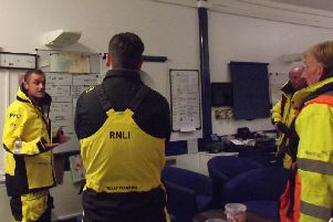 Coxswain Robin Baker briefs the RNLI Lytham St Annes crew before setting on a rescue on the midnight rescue