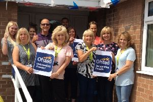 Staff at Oaklands short break home celebrate after receiving an Ofsted outstanding rating
