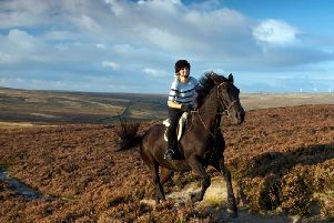 Horse rider gallops across the South Pennine landscape, cited in a Government report on the nations most precious areas.