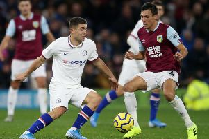 Burnley's Jack Cork, right, and Chelsea midfielder Mateo Kovacic during the Premier League fixture at Turf Moor
