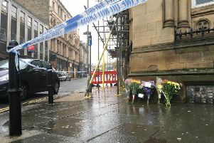 A 26-year-old woman has died in Halifax town centre next to Silver Street