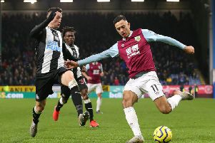 Burnley's Dwight McNeil takes on Newcastle United's Javier Manquillo during the 1-0 win at Turf Moor
