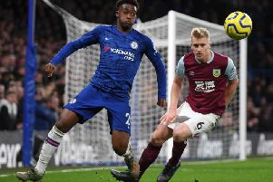 Burnley defender Ben Mee and Chelsea's Callum Hudson-Odoi at Stamford Bridge