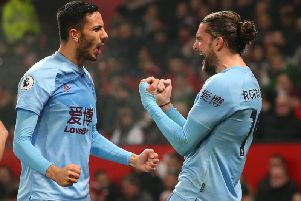 Dwight McNeil celebrates with Burnley goalscorer Jay Rodriguez at Old Trafford