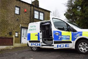 A CSI van parked outside the home on Carr House Lane