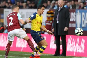 Kieran Trippier vies with Chilean striker Alexis Sanchez during the English Premier League football match between Burnley and Arsenal at Turf Moor on April 11, 2015. AFP PHOTO / LINDSEY PARNABY