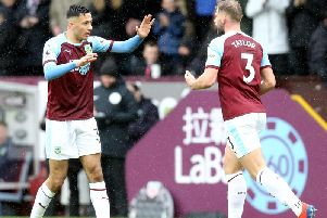Burnley left back Charlie Taylor (right) with Dwight McNeil
