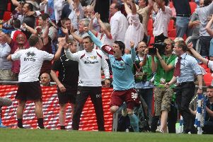 Celebratory scenes as the Burnley players go wild at Wembley after securing promotion to the Premier League