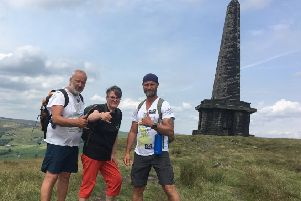 Monumental walk: Daniel Dorney (left) and Mark Hodgson with local deaf resident Jen Dodds.