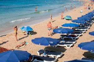 Tourists sunbathe on the beach in the resort of Ayia Napa in Cyprus (Photo: FLORIAN CHOBLET/AFP/Getty Images)