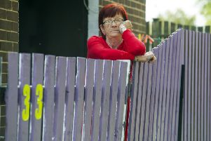 Vera Smallwood has been ordered by WDH to re-paint her fence after she painted it purple. Picture Scott Merrylees